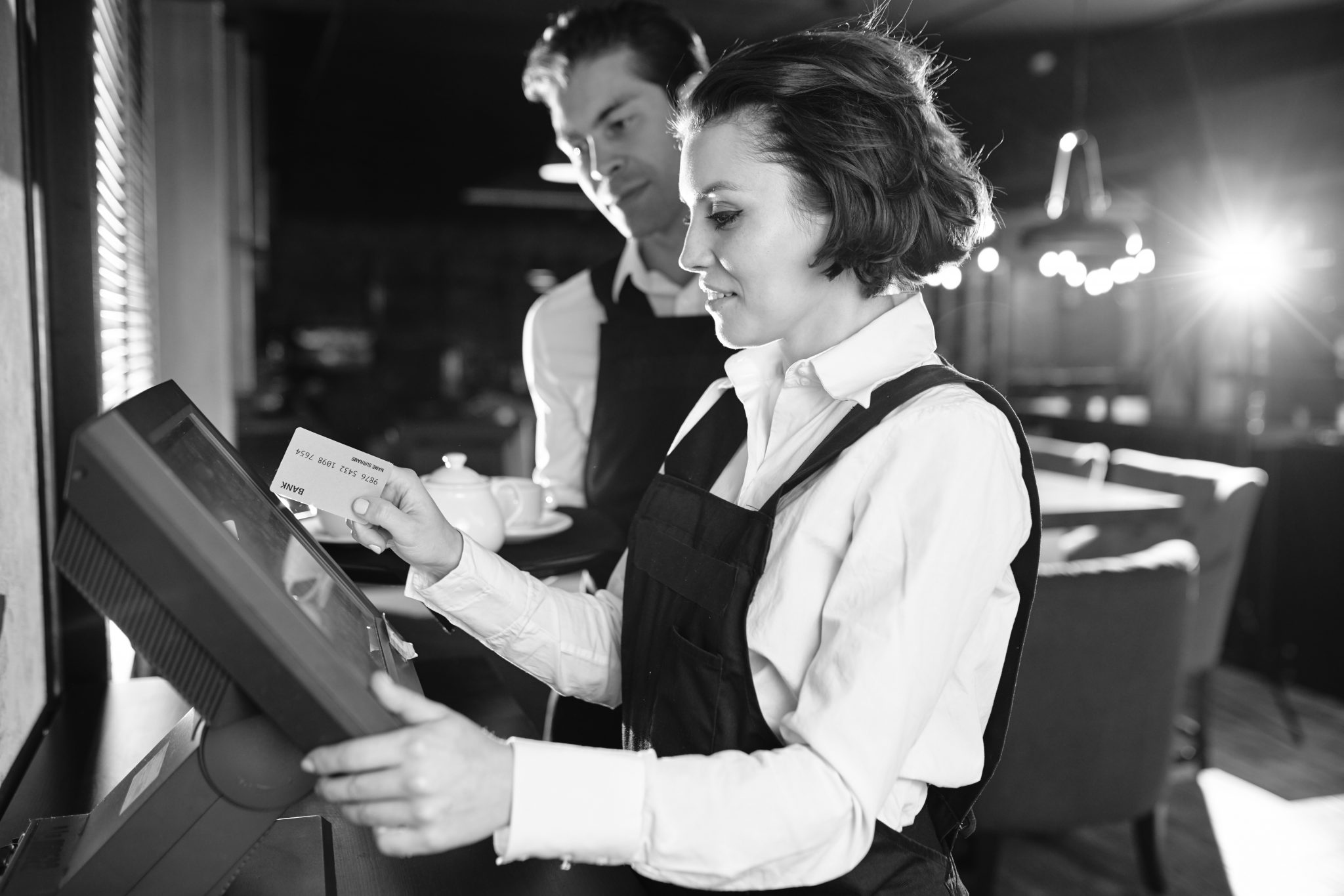 Image of waitress using POS terminal