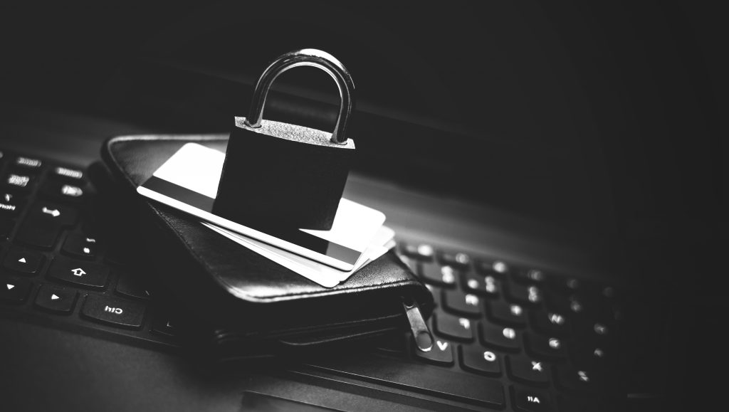 Image of a lock, credit cards, wallet and keyboard